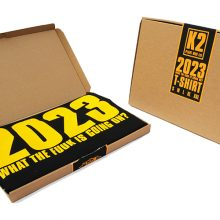 The JAMs 2023 black t packaging open and closed